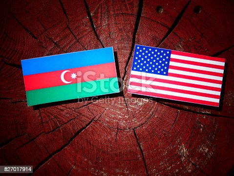istock Azerbaijan flag with USA flag on a tree stump isolated 827017914