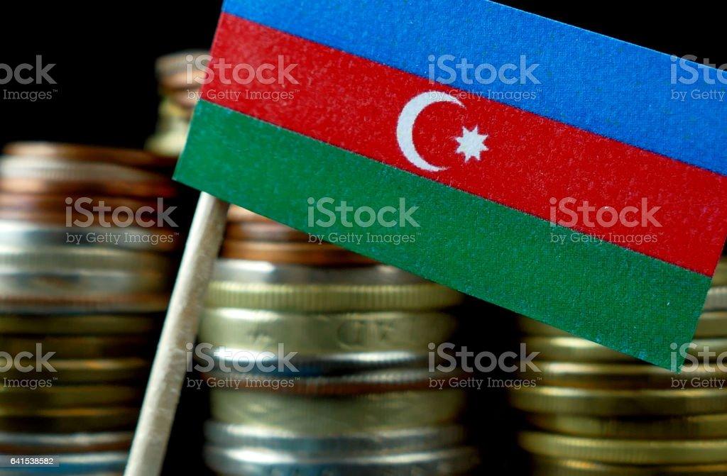 Azerbaijani flag waving with stack of money coins macro stock photo
