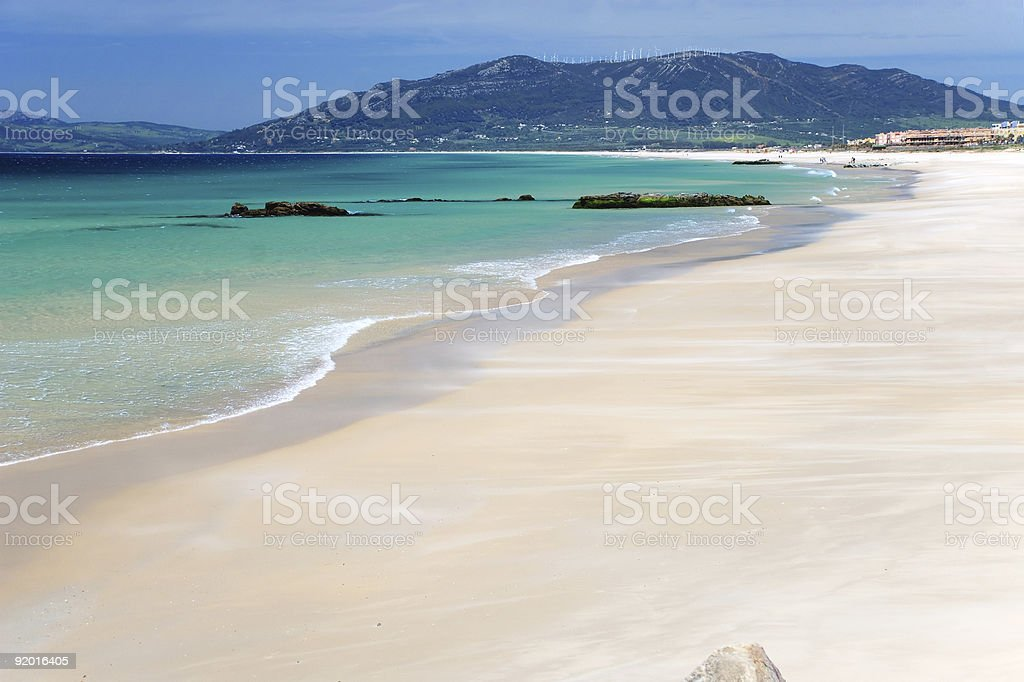 Azure bay near Tarifa and deep blue sky stock photo