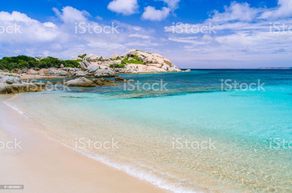 Azure beach with clear water near Porto Pollo on beautiful Sardinia island, Italy stock photo