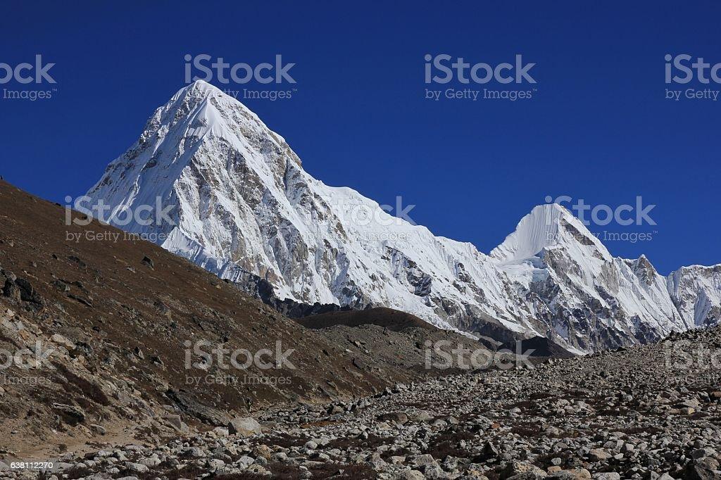 Azure blue sky over mount Pumori stock photo