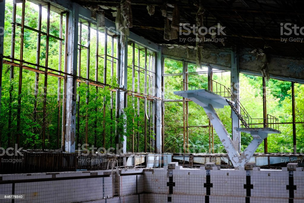 Azure swimming pool in Pripyat, close to Chernobyl in Ukraine stock photo
