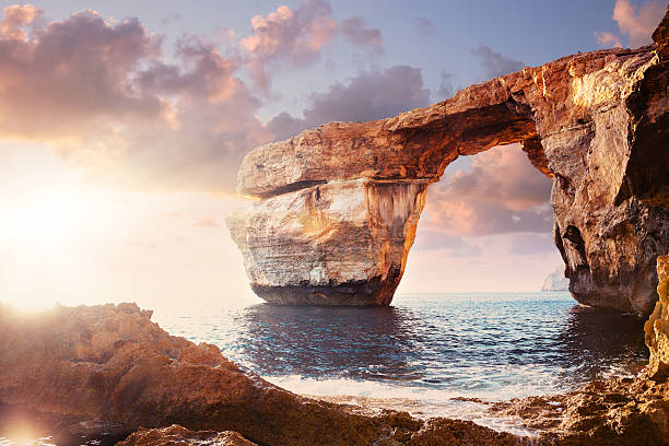 azure window in sunset, malta - rock formations stock pictures, royalty-free photos & images