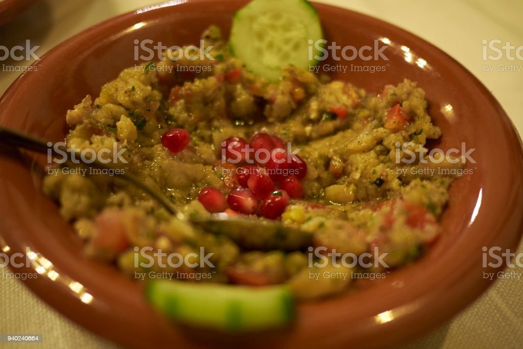 Baba ganoush with pomegranate stock photo
