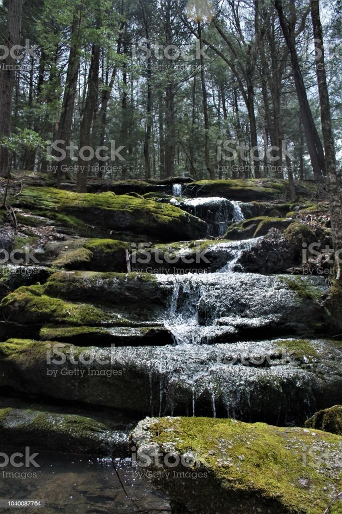 Babbling stream cascading down rocks stock photo