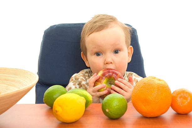 Babby and fruits stock photo