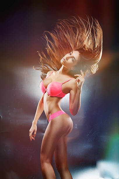 Babe in motion Very beautiful, tall dancer. Frozen motion. Ideal body. Special light effect. hot sexy butts stock pictures, royalty-free photos & images