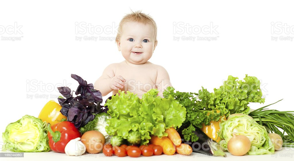 babe with vegetables stock photo