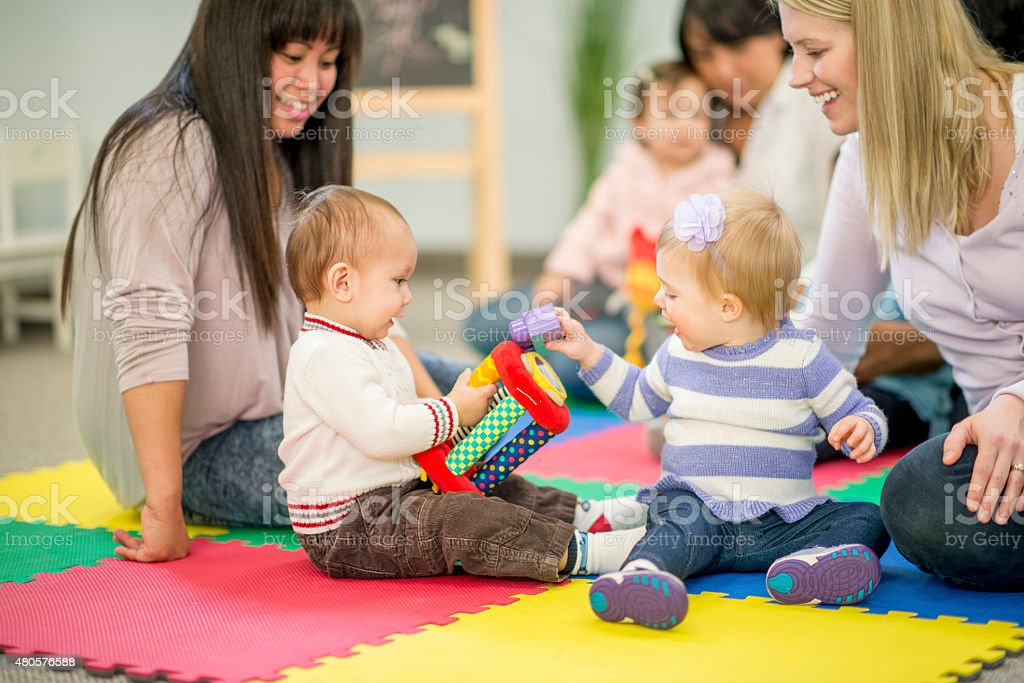 Babies and Mothers in Daycare stock photo