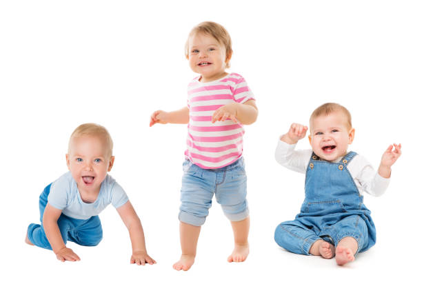 Babies Boys Girls, Crawling Sitting Standing Infant Kids, Growing Toddlers Children on White stock photo