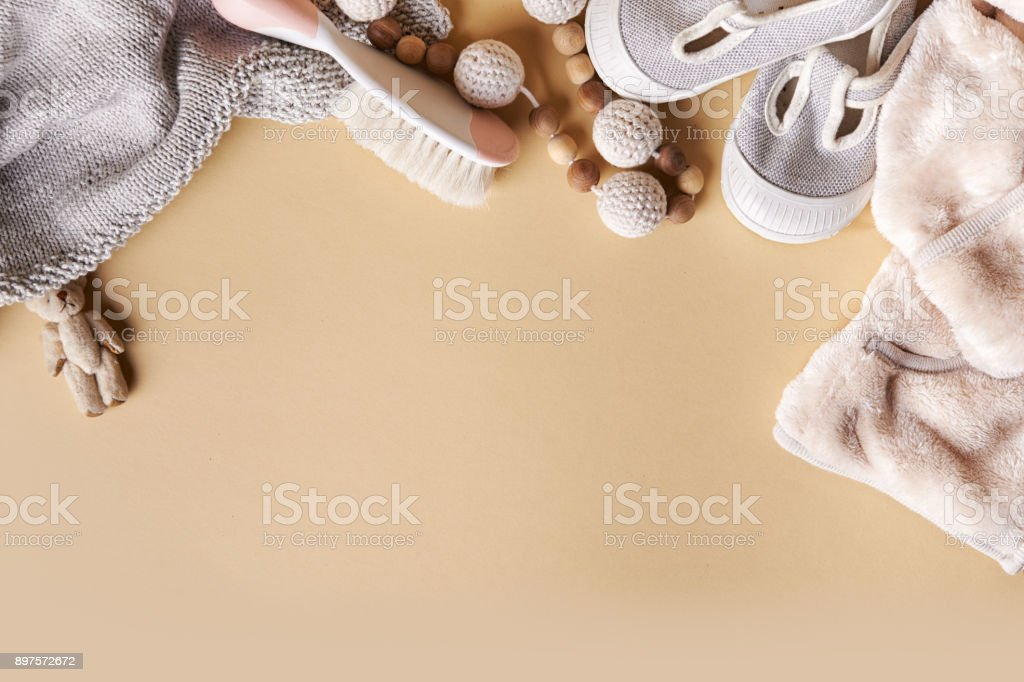 babies clothes and toys stock photo