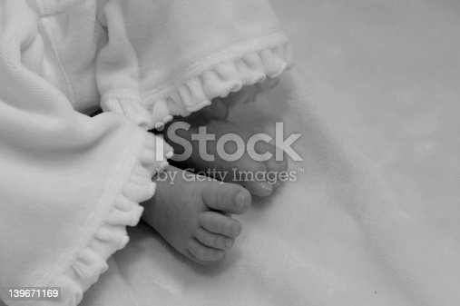 babies feet on changing table