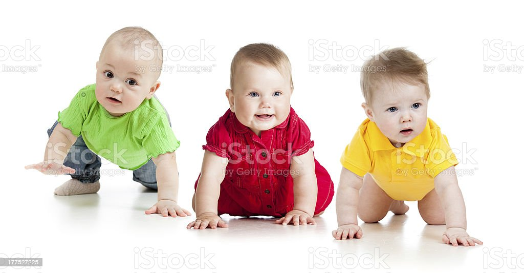 babies go down on all fours stock photo