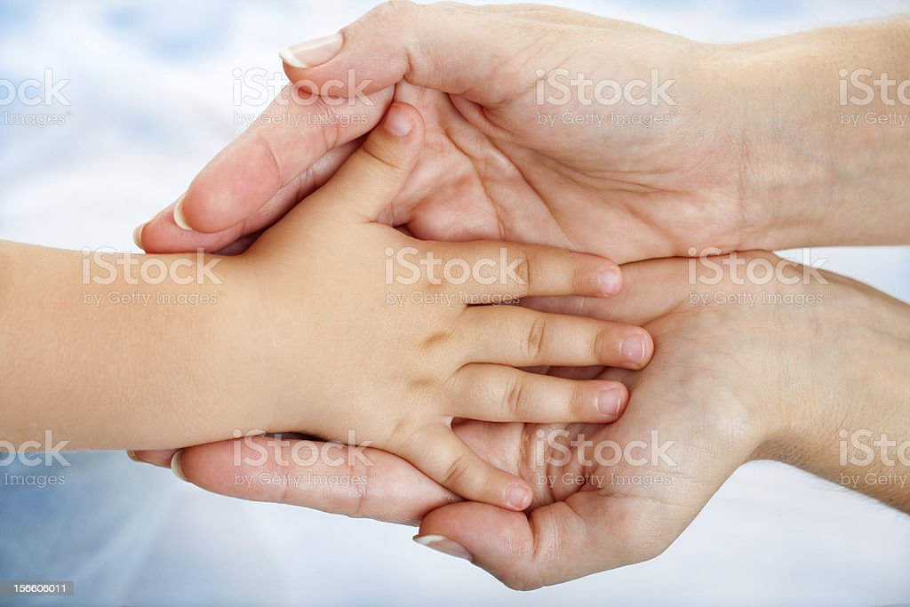 Babies hand resting on mothers. royalty-free stock photo