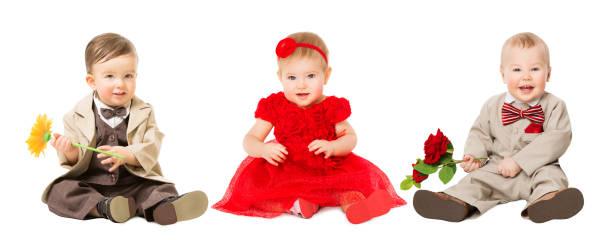 babys kinder gut gekleidet, elegant kinder mit blume, mode jungen und mädchen auf weiß - festliche babymode junge stock-fotos und bilder