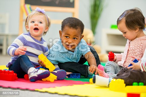 Diverse group of babies playing.