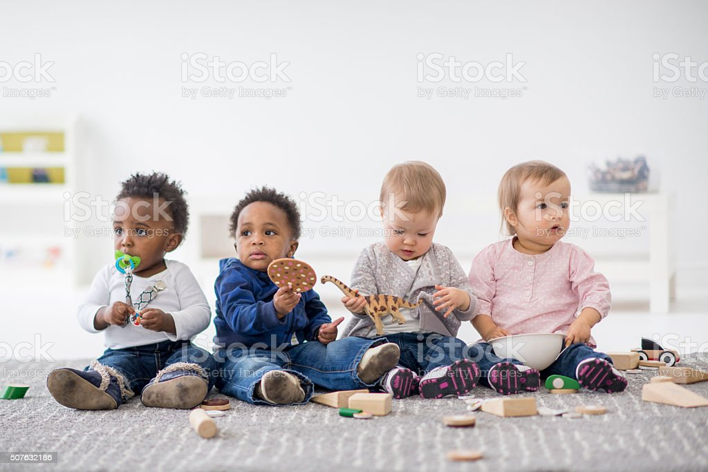 Kinder Garden: Babies Playing Together In Preschool Stock Photo & More