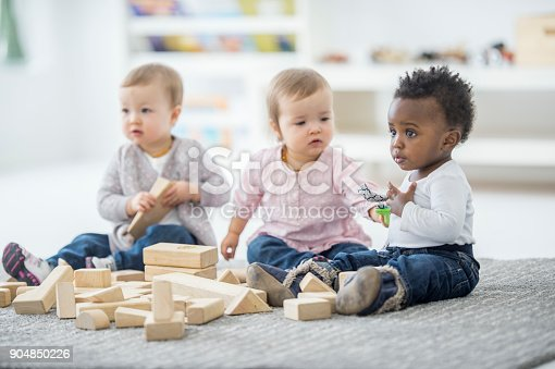 istock Babies Playing Together 904850226