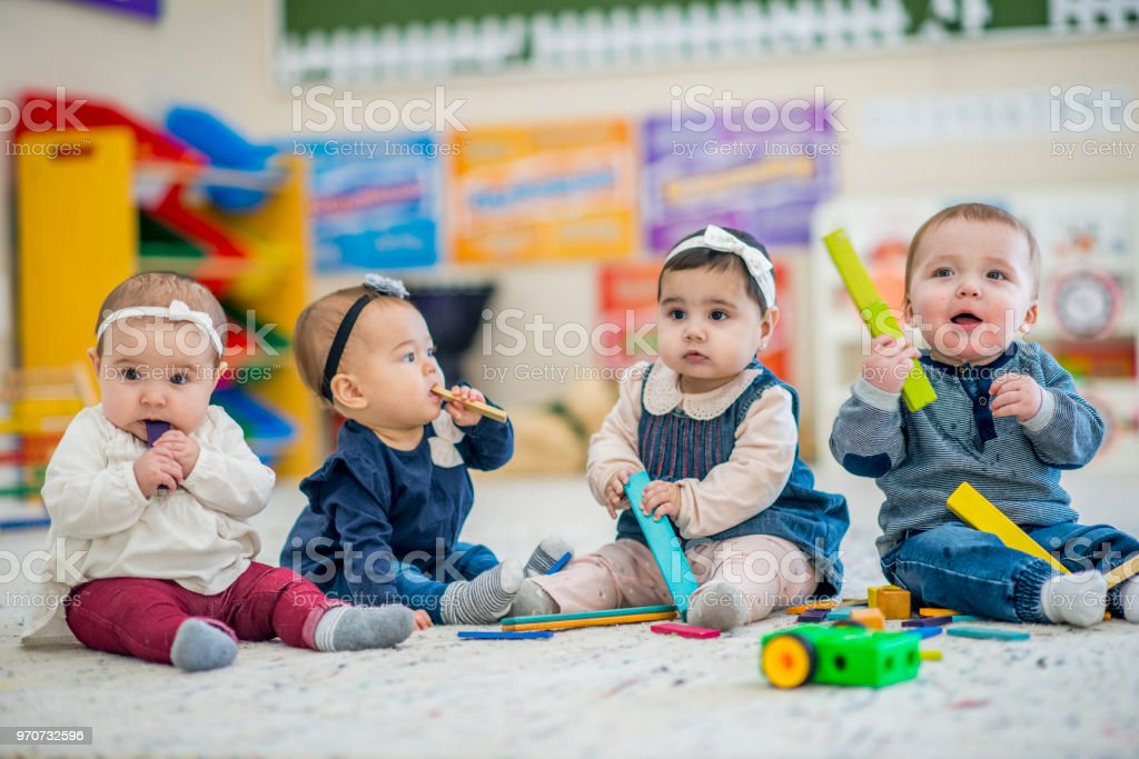 Babies Playing Together stock photo