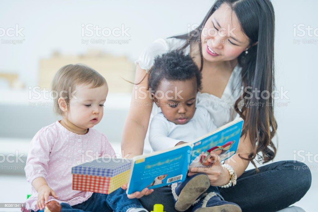 Babies Reading stock photo