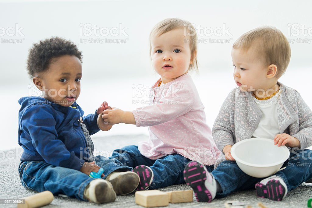 Babies Sharing Toys stock photo