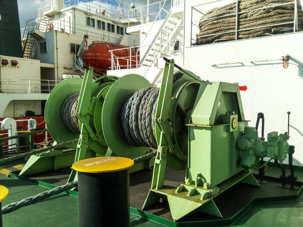 babina with a sea mooring rope. mooring on the ship - cable winch stock photos and pictures