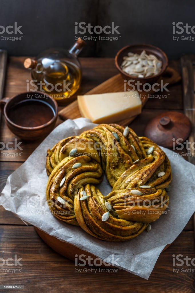 Babka Brioche Wreath with Pesto and Parmesan stock photo
