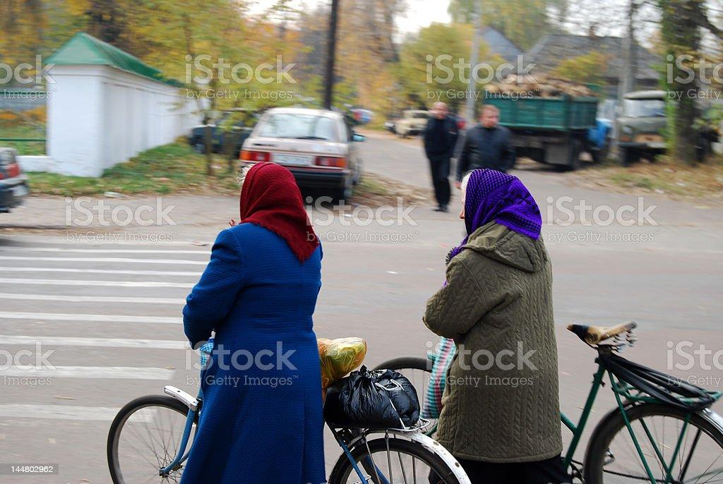 Babushkas crossing the street stock photo