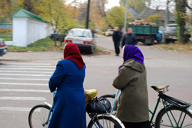 Babushkas crossing the street stock photo