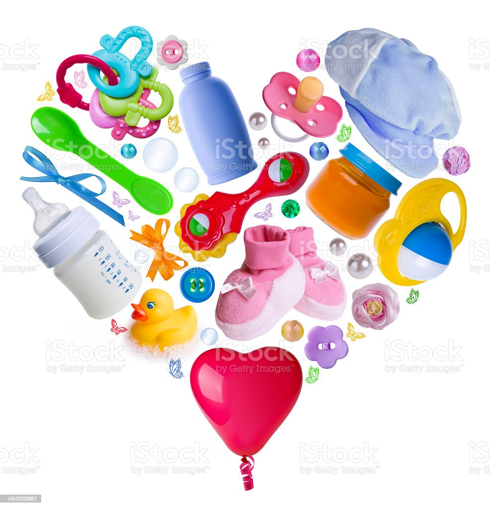 Baby accesories arranged in a heart shape stock photo