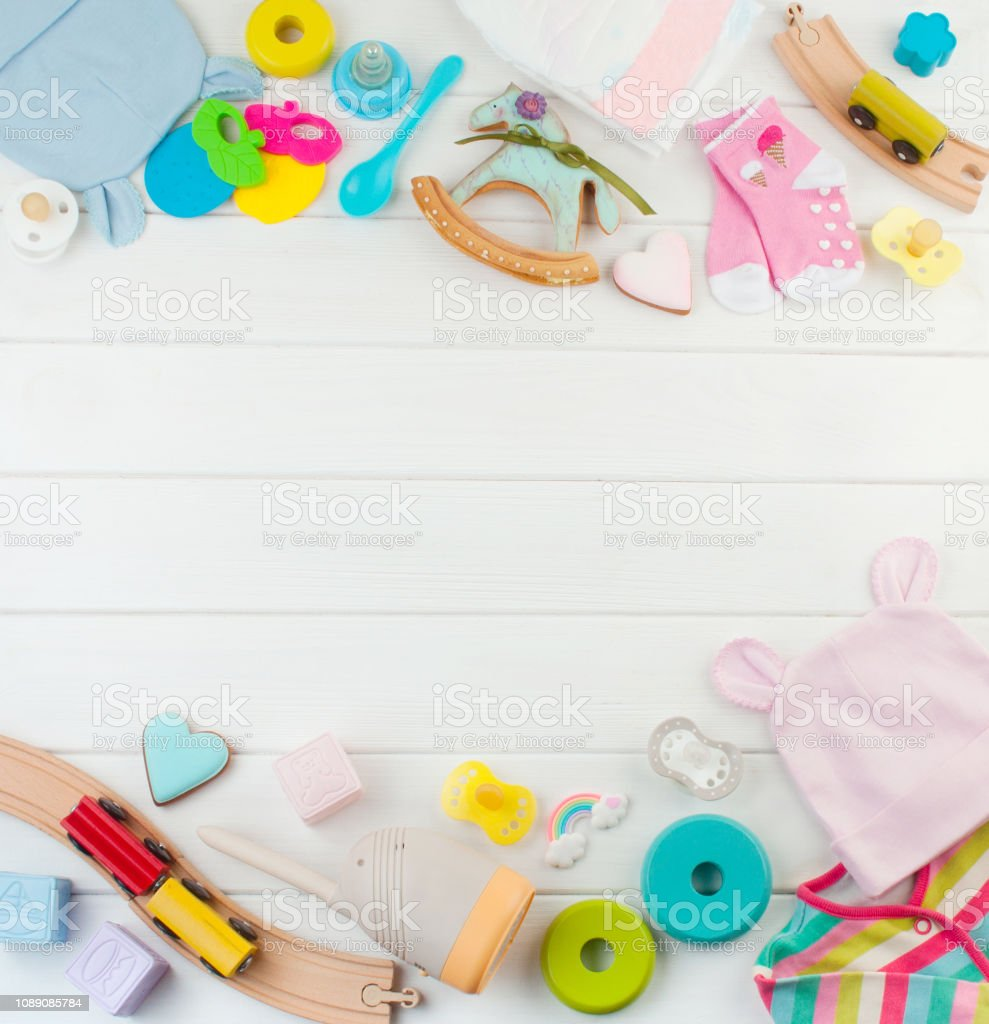 Baby accessories and toys on white wooden background stock photo