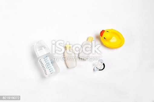 istock Baby accessories for bath with duck on white background. Top view 821919072