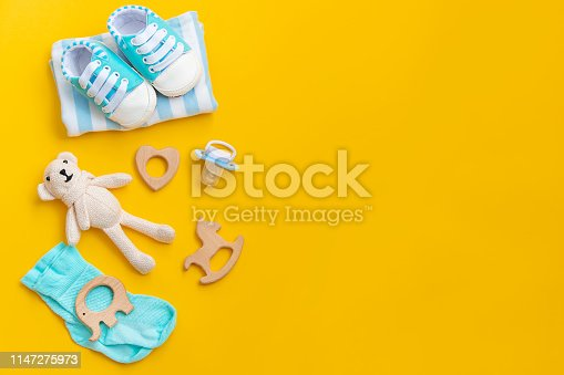 istock baby accessories for newborns on a colored background. selective focus. 1147275973