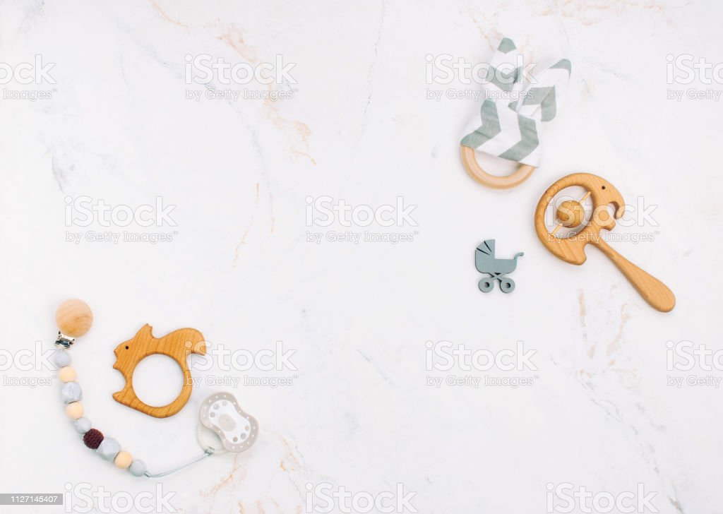 Baby accessories on light marble background stock photo