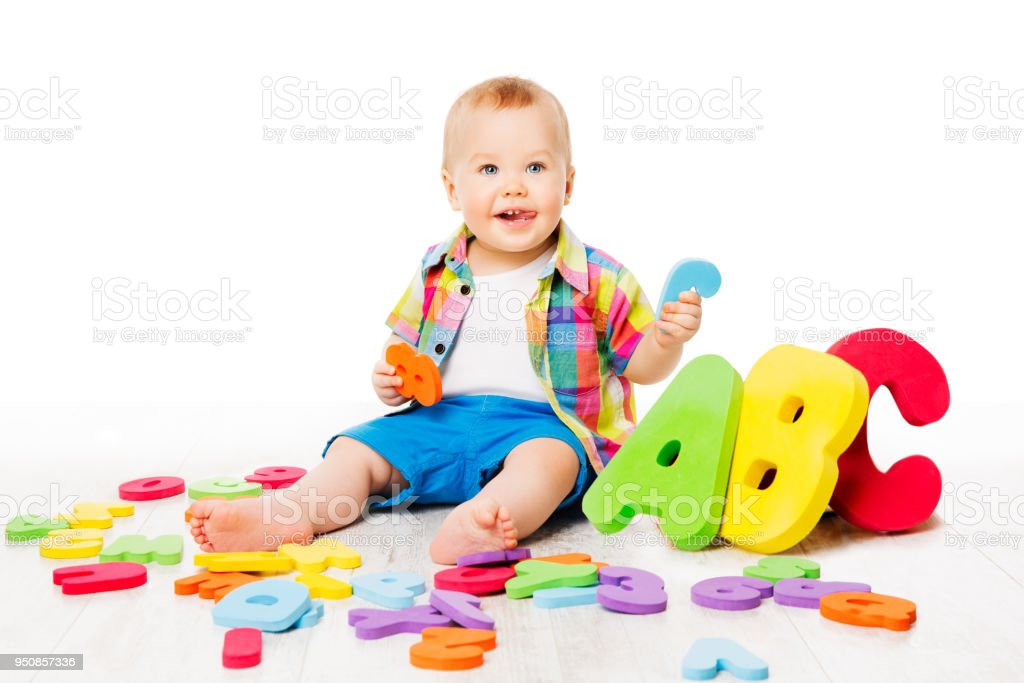 Baby Alphabet Toys, Child Playing Colorful ABC Letters, Kid over White, Early Education concept stock photo