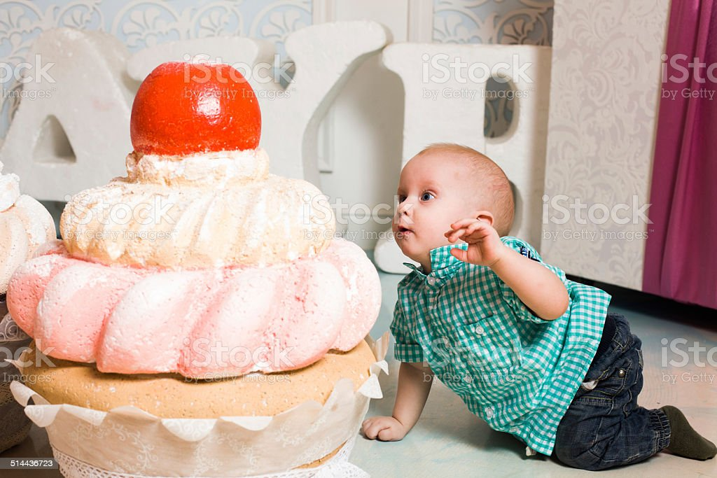 baby and a large cake stock photo