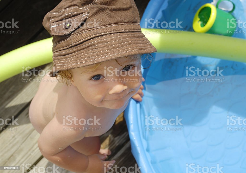 Baby and a paddling pool royalty-free stock photo