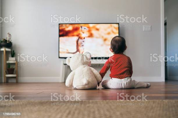 Photo of Baby and Bear Watching TV
