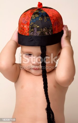 istock Baby and Chinese New Year Hat. 182097103