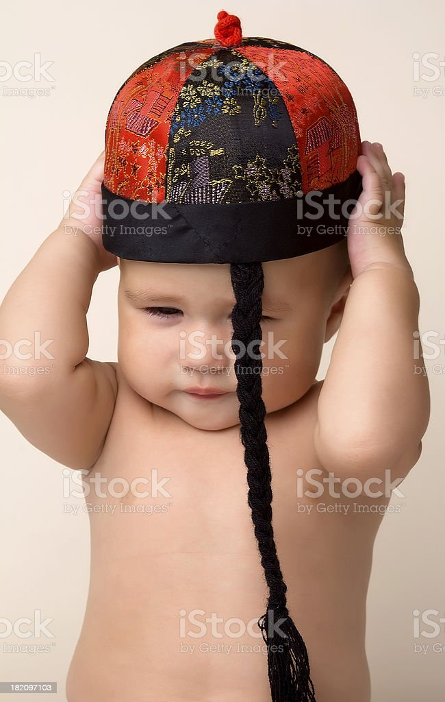 Baby and Chinese New Year Hat. stock photo