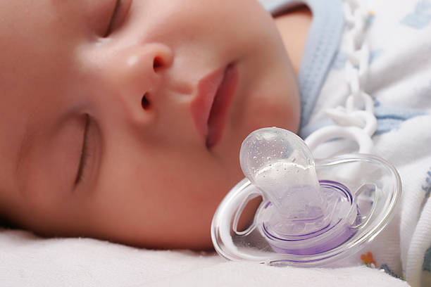 baby and dummy a new born sleeping baby with dummy ventriloquist's dummy stock pictures, royalty-free photos & images