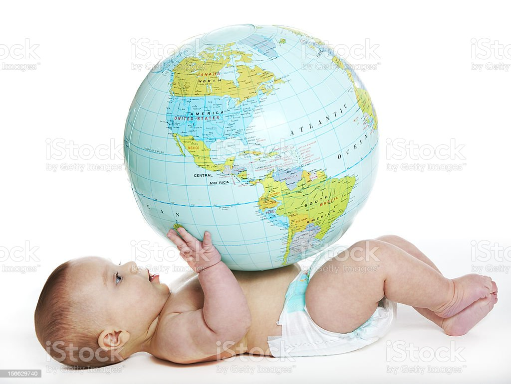 Baby and earth globe Baby girl studying an earth globe 0-11 Months Stock Photo