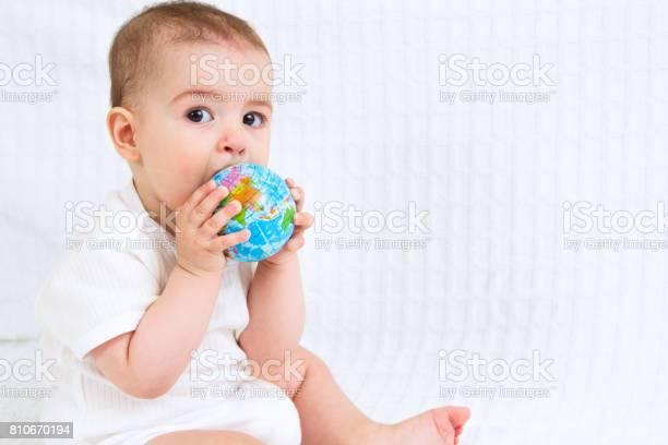Baby and globe isolated on white background picture id810670194?b=1&k=6&m=810670194&s=612x612&h=yj65j1rzbv6y5ftv6d1itidarfguz1cjy8ihuifbctu=
