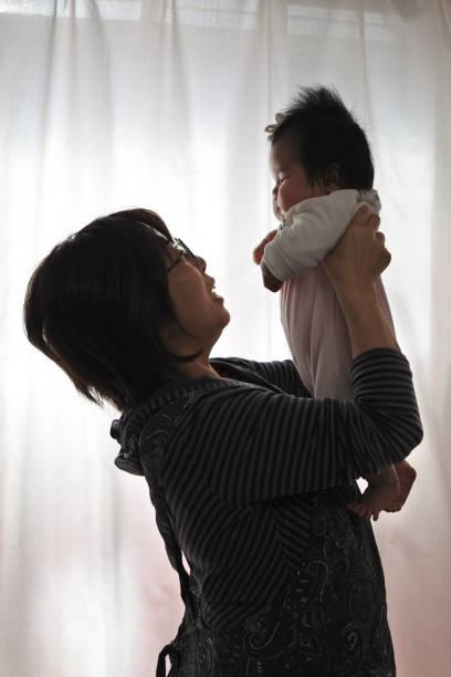 Baby and Grandma stock photo