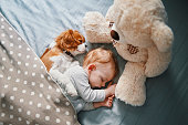 istock baby and his puppy sleeping peacefully 942205880