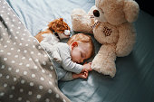 istock baby and his puppy sleeping peacefully 942206052