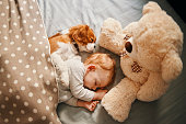 istock baby and his puppy sleeping peacefully 942206698