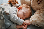 istock baby and his puppy sleeping peacefully 942206720