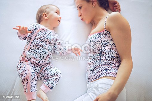istock Baby and mom resting 528904258