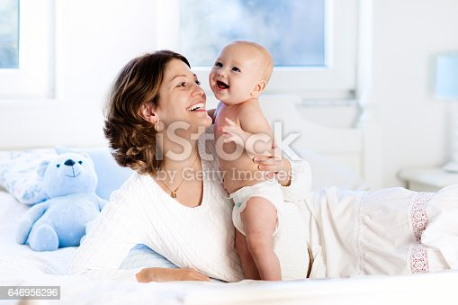 istock Baby and mother at home in bed. Mom and child. 646956296